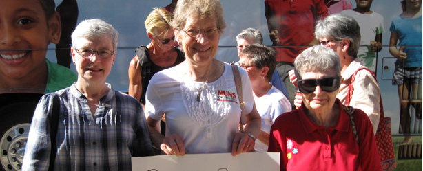 "Sisters Judith Diltz, Melanie Rauh and Joan Fisher attended the ""Nun's on the Bus"" rally to show their support."