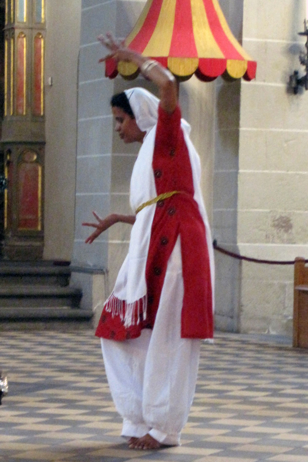 "Sister Mychelin dances the ""Our Father"" at the St. Kastor Basilica."