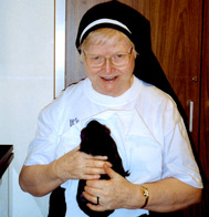 Sister Clarence with her pet guinea pig, Spike